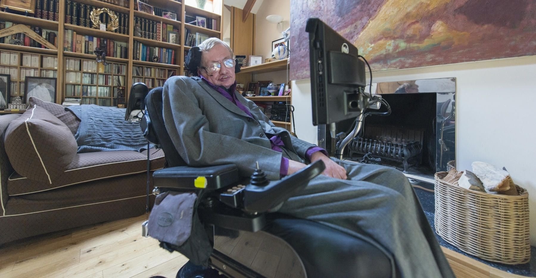 Stephen Hawking in his home library (Credit: PCWorld.com)